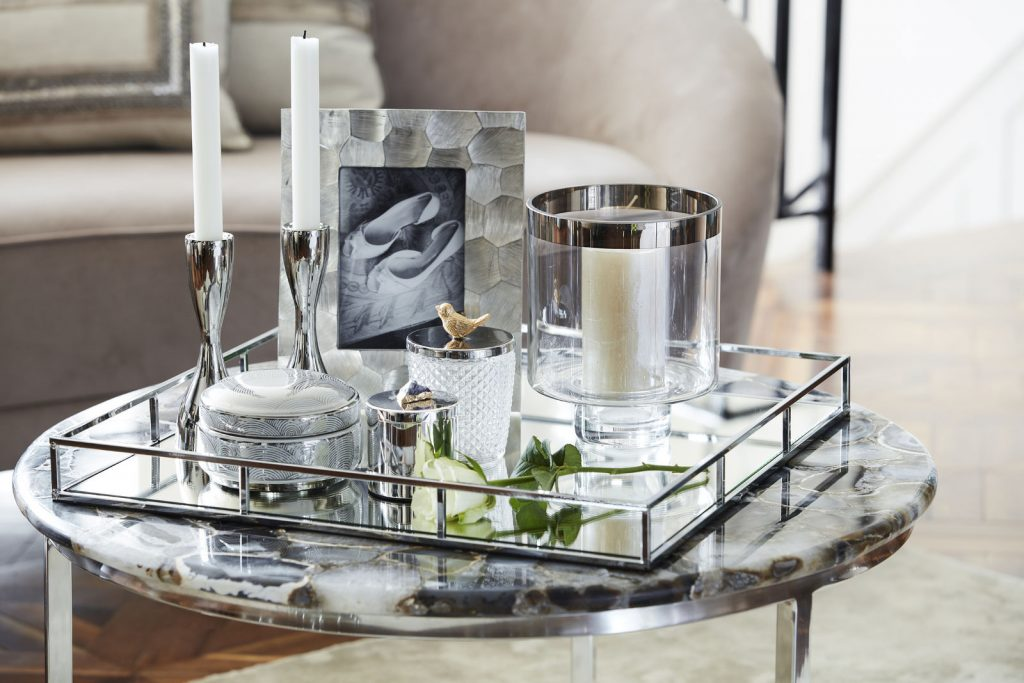 Decorative candles and photo frame on side/coffee table
