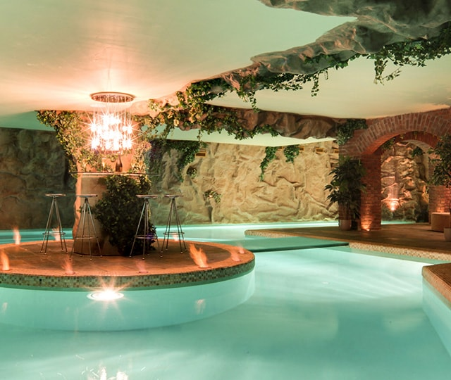 Subterranean pool and bar at luxury home, the caimans